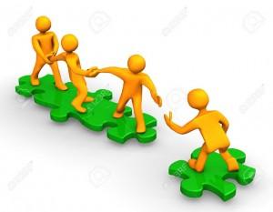 9928246-Orange-dibujos-animados-en-los-puzzles-verdes-simbolizan-un-trabajo-en-equipo--Foto-de-archivo